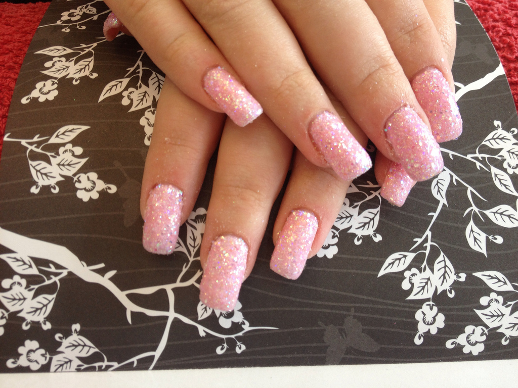 Gel nails with pink gel polish and glitter dust - Nail Designs For You