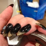 Black and Gold Glitter Stiletto Nails
