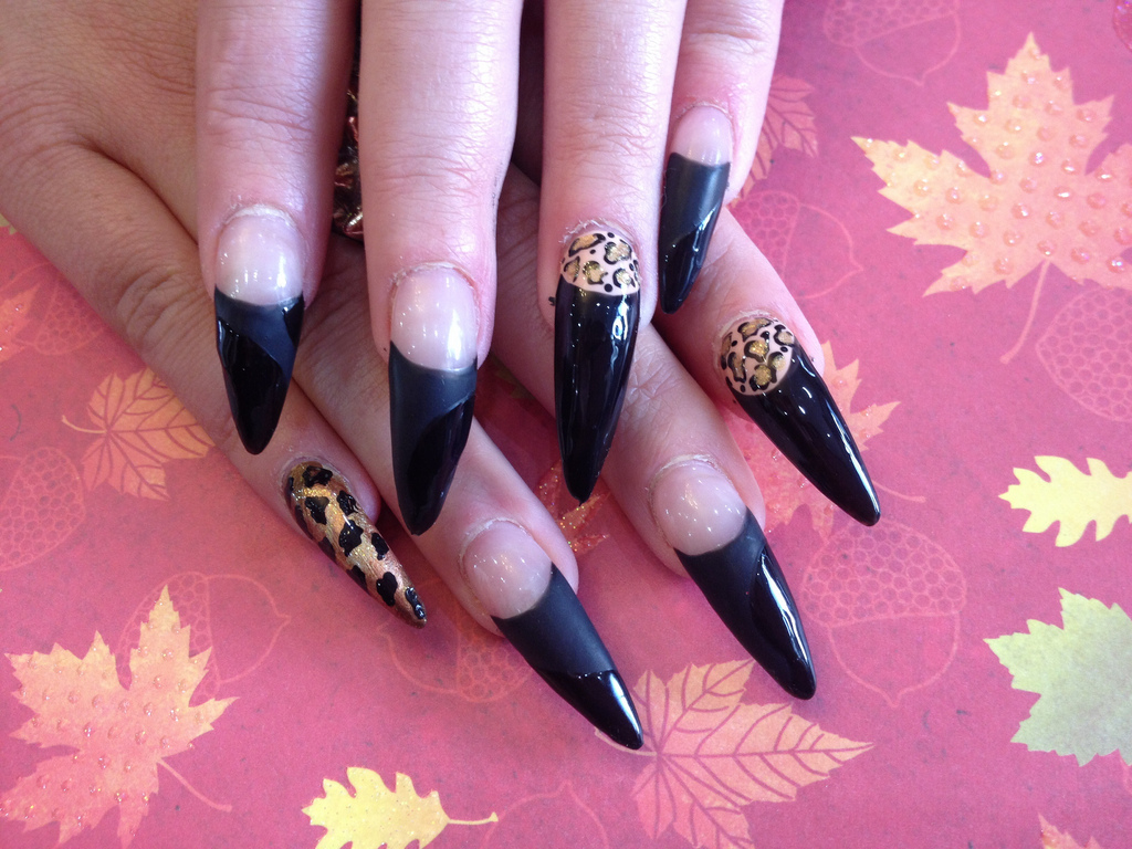 Stiletto Nails With Black Tip And Leopard Print Nail Art