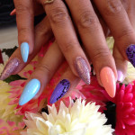 Stiletto Nails With Different Coloured Polish