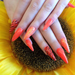 Stiletto Nails With Orange Gel Polish and Zebra Print Nail Art.jpg