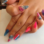 Stiletto Nails with Pink And Blue Nail Art