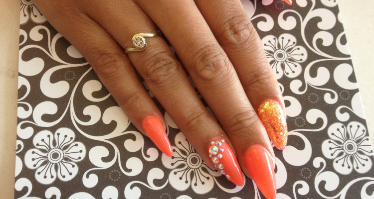 Stiletto Nails With Orange Gel Polish Glitter And Swarovski