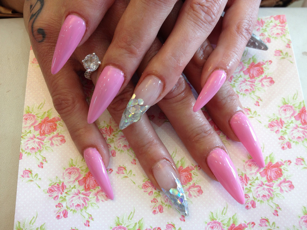 Stiletto Nails With Pink Gel Polish And Glitter In Ring Fingers Nail Designs For You