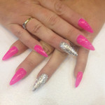 Stiletto Nails with Pink Gel Polish and Silver Glitter