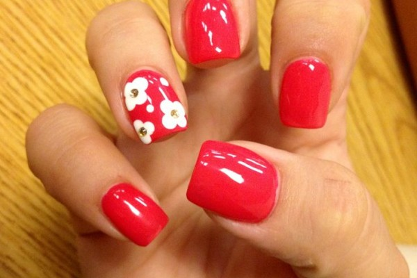 ... nail polish with white flower design and gold gem. - Nail Designs For