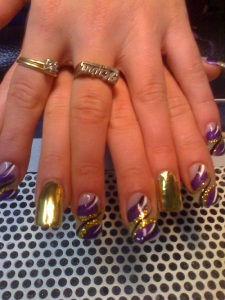 Elegant Purple and Gold Nail Design