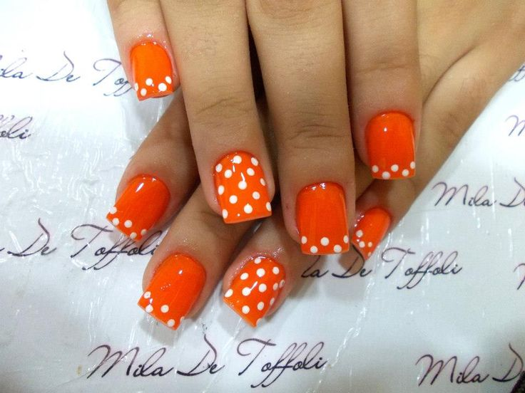 White Polka Dots and Orange Nails