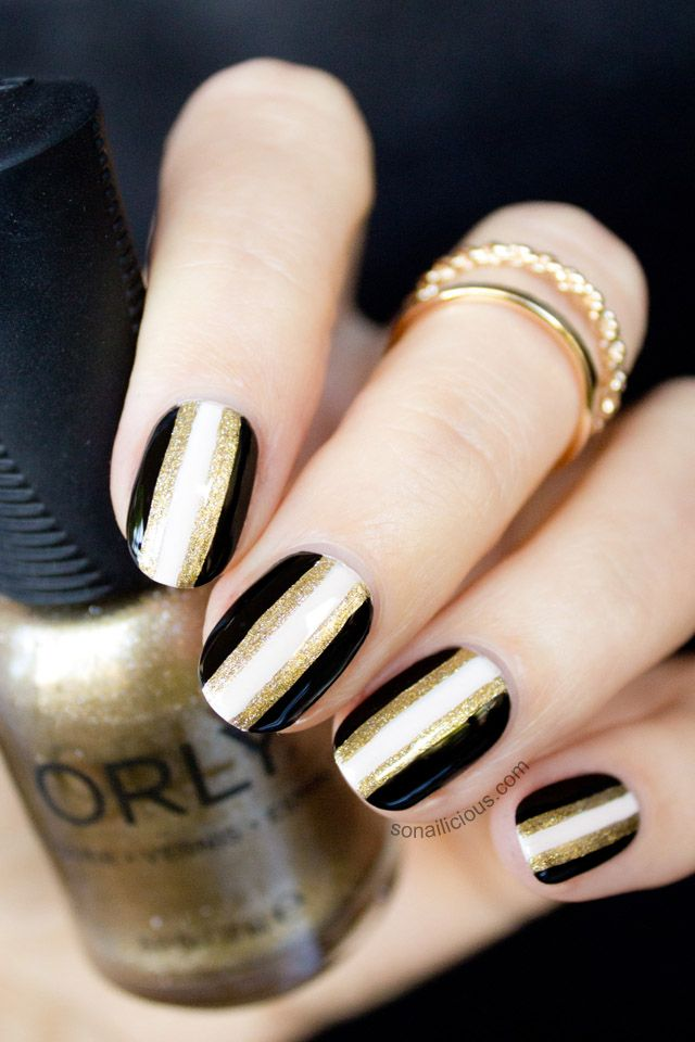 black and gold glitter striped nails