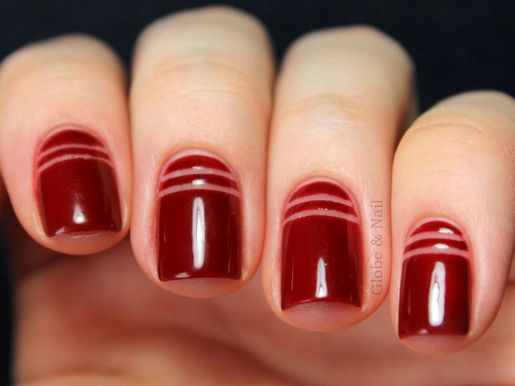negative space striped red manicure